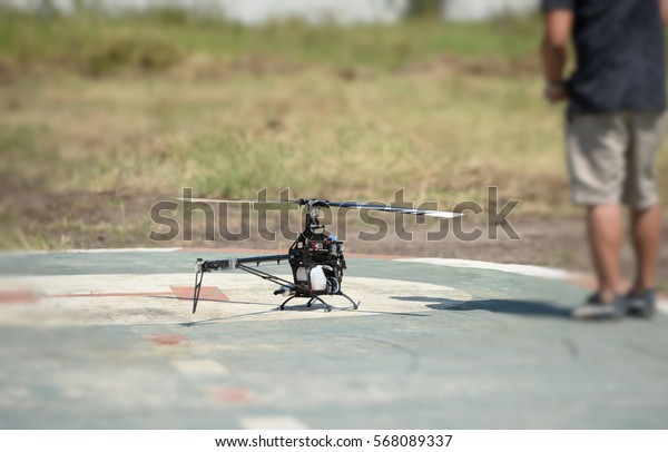 Man plays a remote control helicopter