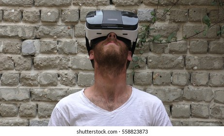 A man plays virtual augmented reality game using head mounted display Interactive 3D Holograms visor