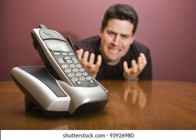 A man pleads for the phone to ring