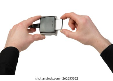 A man plugs in a Compact Flash Card into the card reader.