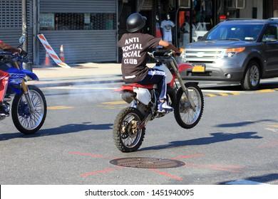 man pm mountain motor bike do wheelie on a bike on Fulton street in the crown heights Brooklyn July 15 2019
