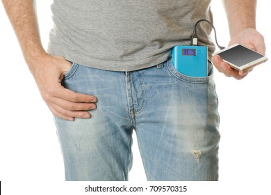 Man in a pocket mobile phone smartphone and a power bank on a white background isolation