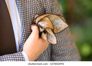 man with pocket square wearing elegant clothes tie, shirt and jacket tailor-made