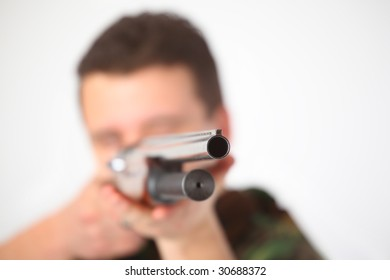 man pointed from gun, focus on muzzle