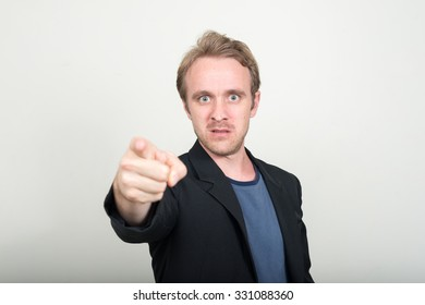 Man pointing angrily to camera