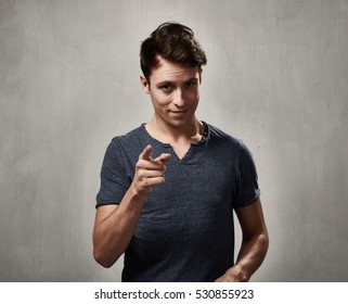 Man pointing to the camera