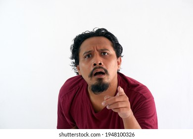 man pointing finger at camera with wondering face expression, confuse asian guy looking at you