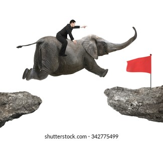 Man with pointing finger gesture riding elephant flying toward red flag on cliff, isolated on white background.