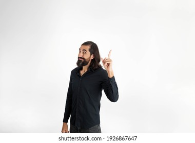 man pointing finger up to site for copy space