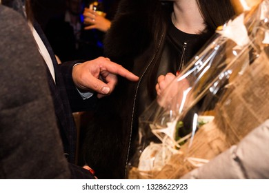Man pointing forefinger on woman. Shallow depth of field.