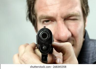 Man pointing with gun