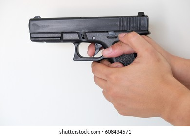 Man pointing a gun at the target on white background