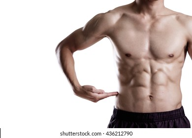 A man pointing hand on his six pack isolate on white background.