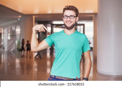 man pointing at his t-shirt (can be used as a clothes design template)