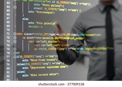 man pointing on virtual screen with website programming code (There is no potentially infringes on intellectual property rights)