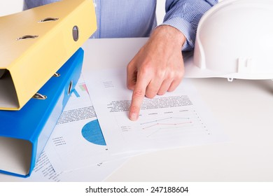 A man pointing raport with a finger - office