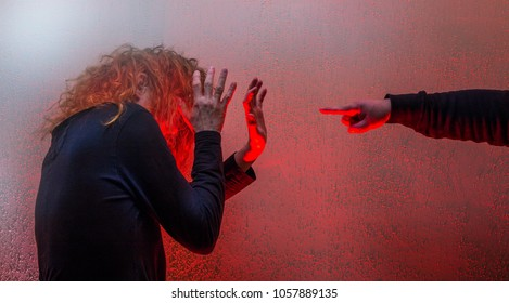 a man points to a woman and threatens her