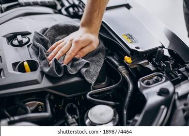 Man polishing car inside at car service