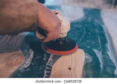 man polishing epoxy table. Epoxy furniture