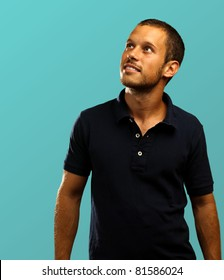 man with polo shirt on a blue background