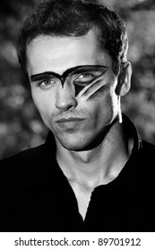 man portrait, hard handsome male model with military makeup - black and white version