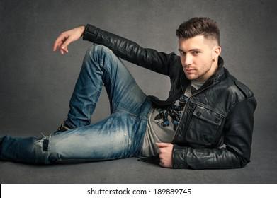 Man portrait over dark grunge background.