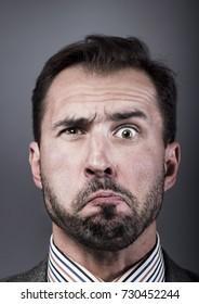 Man portrait with a strange expression
