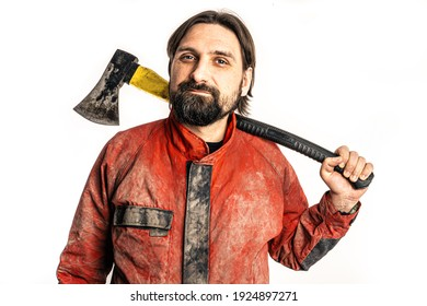 The man poses with an ax in a photo studio.