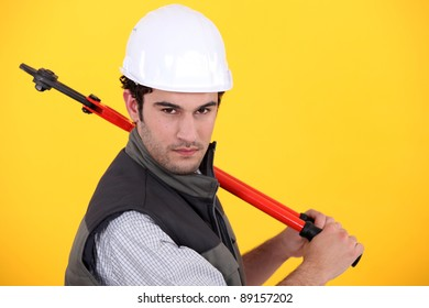 Man posing with bolt-cutters