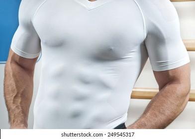 Man posing at gym.