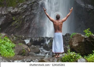 man posing at the jungle waterfall