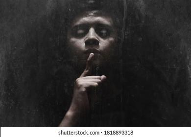 Man possessed on dark background