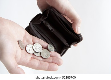 Man pouring coins into empty wallet