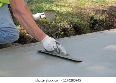 Man Pouring and Finishing a Concrete Driveway