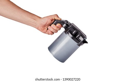 Man pouring from a plastic camping jug on white background, Copy space