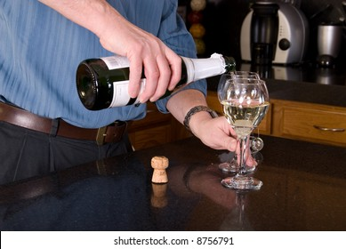 Man pouring wine.