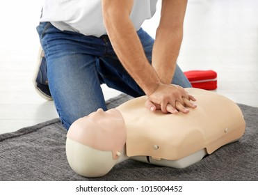 Man practicing first aid on mannequin, closeup