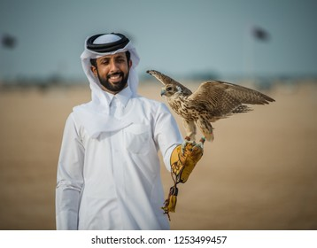 A man practicing hunting with falcons, north of Qatar, December 2016