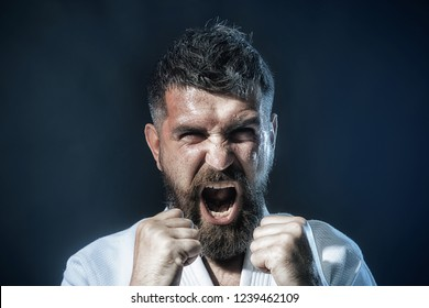 Man practicing karate martial art. Sportsman exercising karate martial art combat, self defense. Bearded man in traditional kimono practicing karate, martial arts, mixed martial arts, MMA, kick boxing