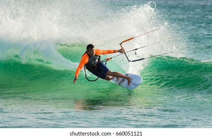 Man practicing kitesurfing on the waves of Tarifa
