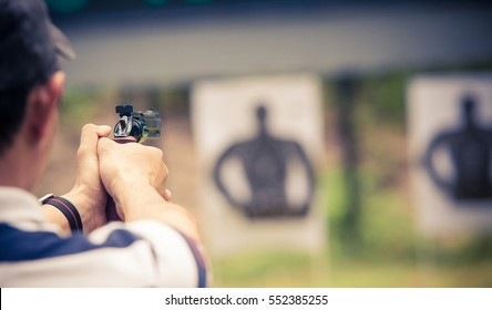 Man practicing shooting gun.focus gun