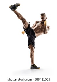 Man practicing tae-bo exercises, kicking forward with legs. Photo of sporty muscular male wearing sports clothes over white background