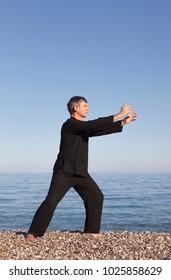 Man practicing Tai Chi -?? Posture Push