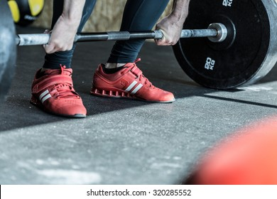 Man practicing weight lifting in the exercise room