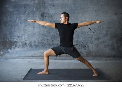 Man practicing yoga against a urban background