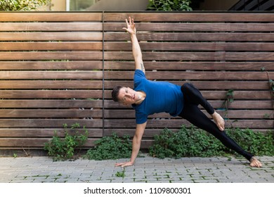 Man practicing yoga in the garden