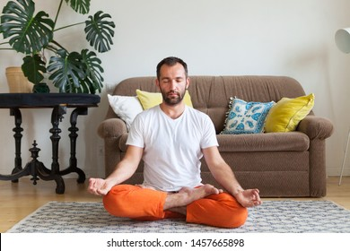 Man practicing yoga and meditation at home. A series of yoga poses. Lifestyle concept.