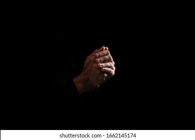 Man pray for something over the black background
