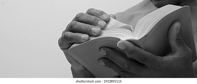 man praying with the bible on white background stock photo