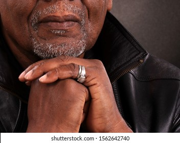 man praying in church with black background stock photo